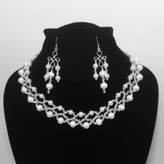 HAPPY EVER AFTER  A spectacular design of fresh water pearls and crystals.  This creation has a...