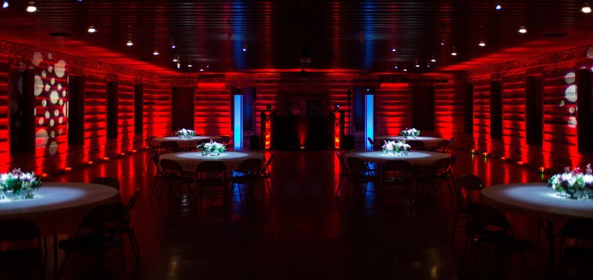 Red uplighting and floral pinspot lighting