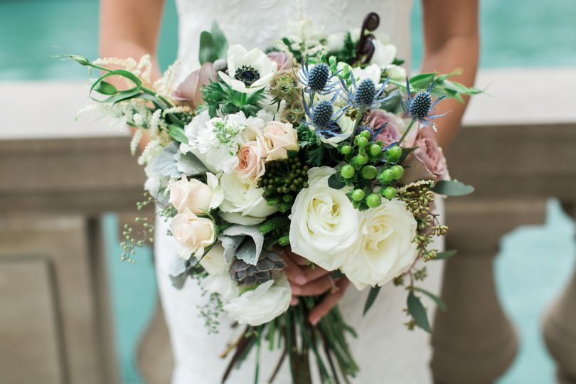 Lush hand tied, elegant, natural florals with garden roses