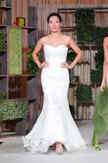 """""""Blooming Amour"""" strapless sweetheart fit-and-flare bridal gown designed with sequin and lace..."""