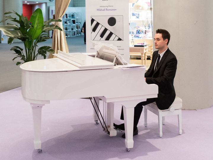 Performance with a white grand piano
