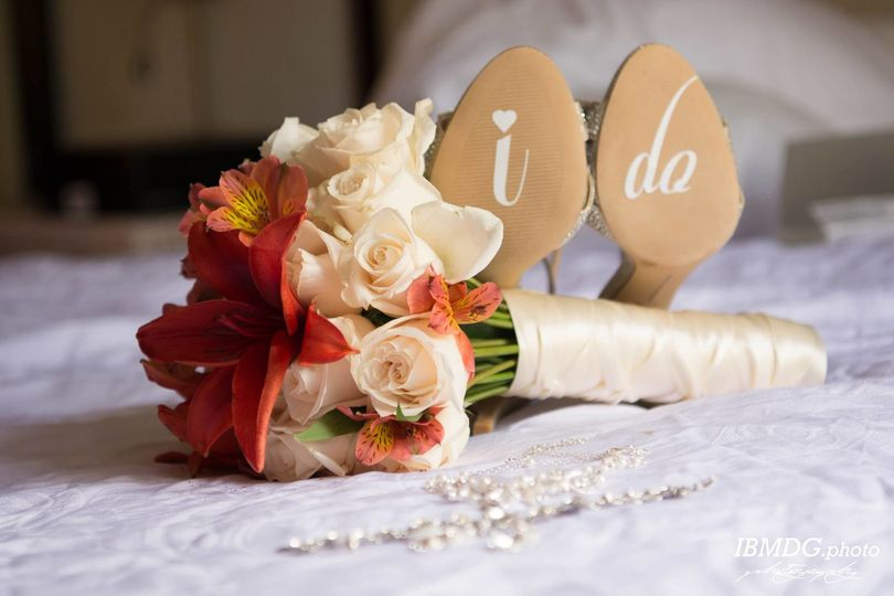 Bridal shoes and her bouquet