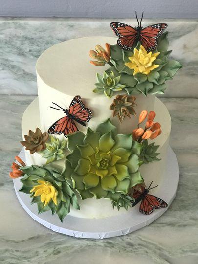 Handmade sugar succulents with silk butterflies