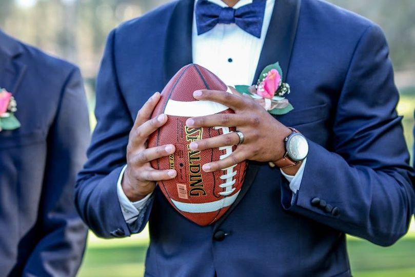 Groom holding football