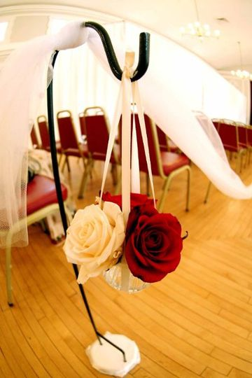 Custom Flower Adornments Guide The Couple Down The Aisle.