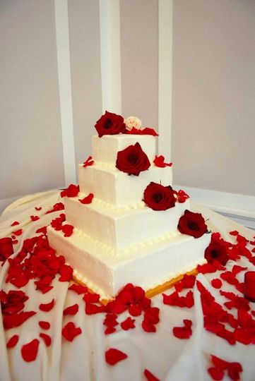 The Wedding Cake... Decorated w/ Fresh Red Roses & Petals!