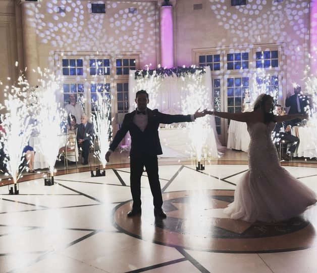Our Mr. & Mrs. enjoying their first dance with indoor fireless fireworks visual and intelligent...