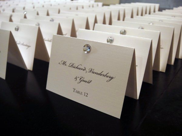 Escort cards printed on linen paper with rhinestone accent.