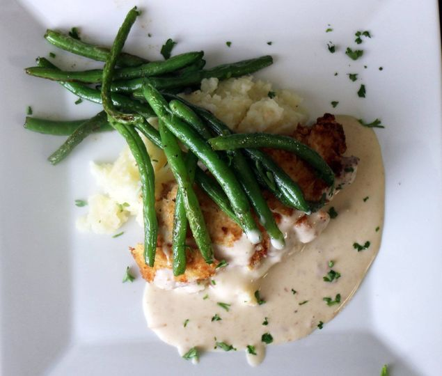 Chicken Irene with homemade mashed potatoes and crispy green beans.