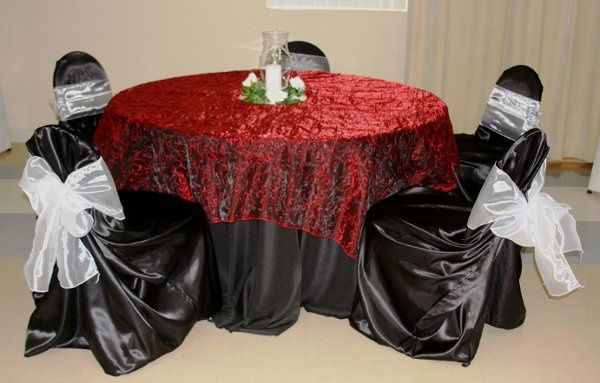 Satin Black chair covers with an Organza Embroidered Overlay on black linen.