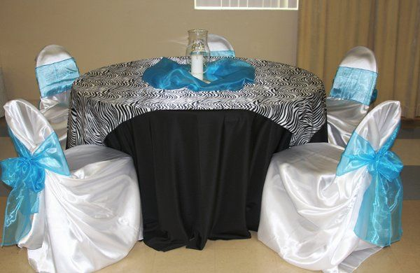 The Zebra overlay with white chair covers, black linen and a touch of tourquiose.  Hot pink goes...