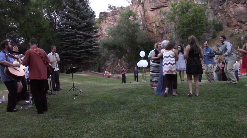 An acoustic performance at an outdoor wedding