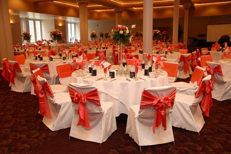 Pink ribbon decor on reception chairs