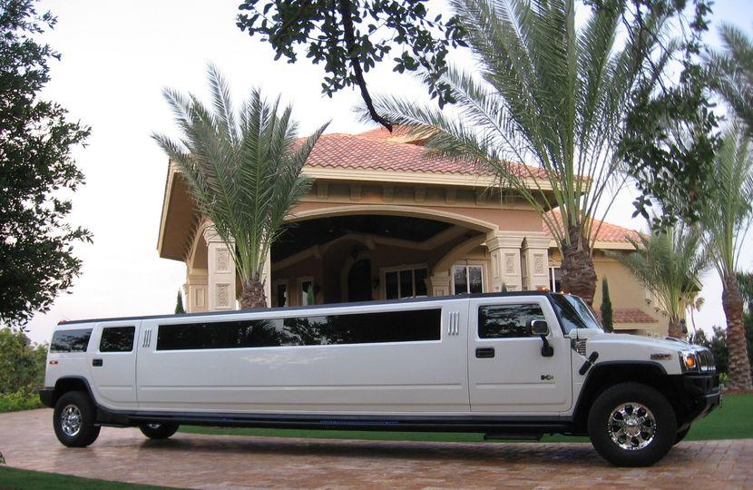 white hummer limo exterior 2