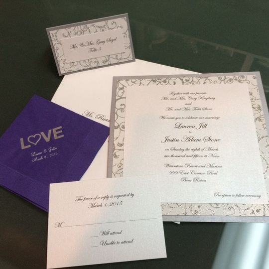 Matching bordered invitation and place card with a personalized napkin.