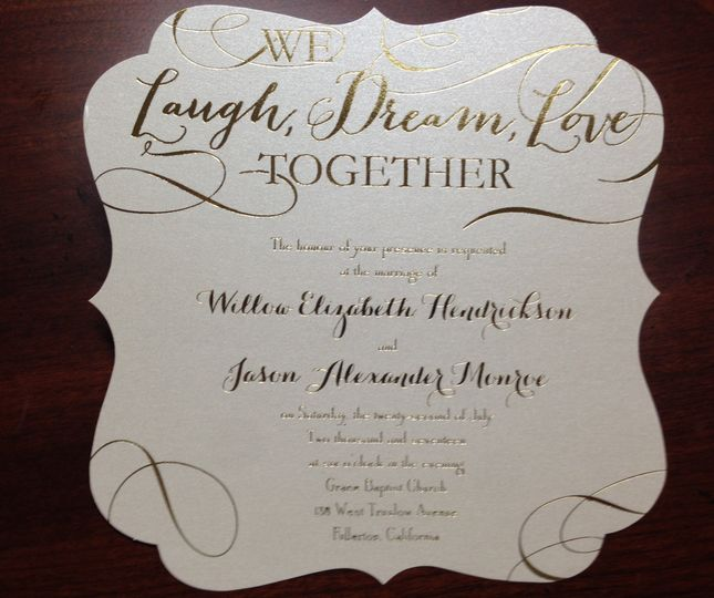 Die cut invitation with gold details.
