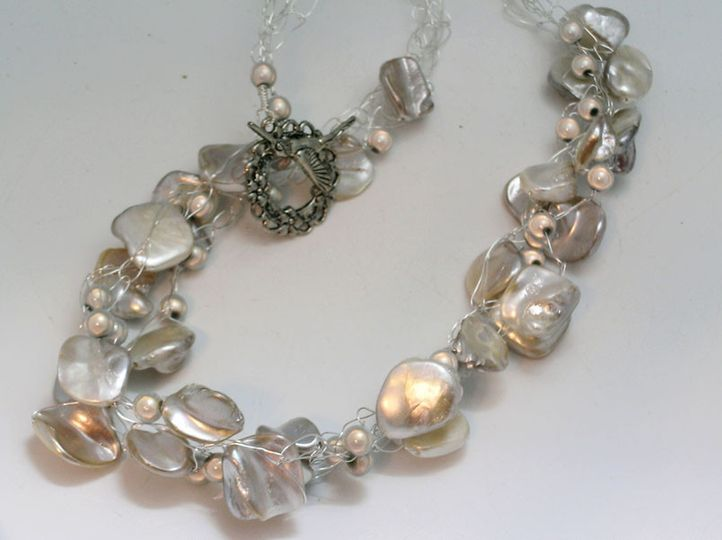 "18"" Necklace of three silver wires loaded with imitation pearls. The wires have been crocheted and..."