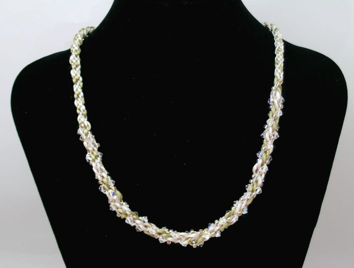 Bright silver wire was used to crochet this 24 inch long necklace. Woven into the crochet pattern...