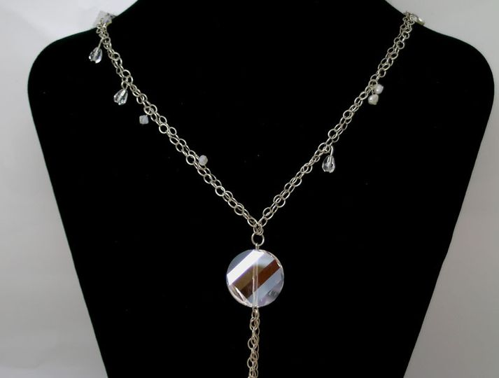 A 1 inch Swarovski Crystal Twist Pendant is the focal point of this double strand necklace.  Two 30...