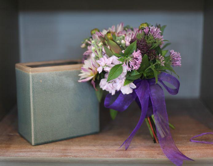 Purple ribbon on bouquet