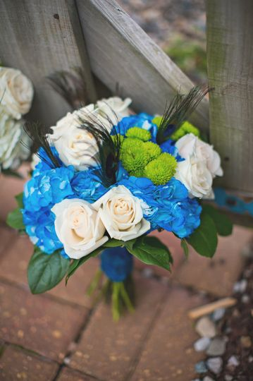White roses and blue flowers