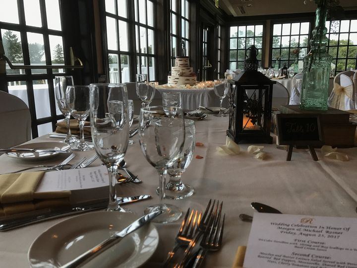 Table setting with lantern centerpiece