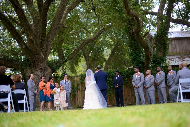 Intimate ceremony under oak trees at the Honey Bee Ranch Event Center.
