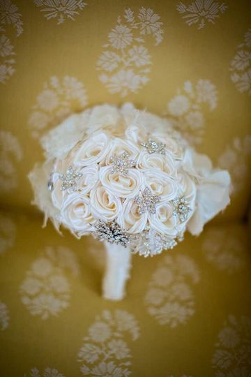 The embellishment on the handle is from the collar of Mom's wedding gown. The collar underneath the...