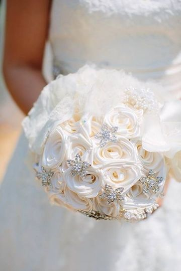 The gorgeous result of merging new and old. The fabric flowers were cut from the lace, satin, and...