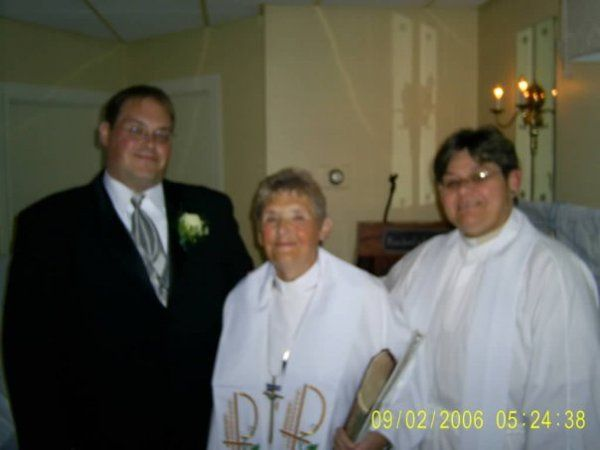 This was my brother-in-laws' wedding. The third person in the picture is my Deacon. She is also...
