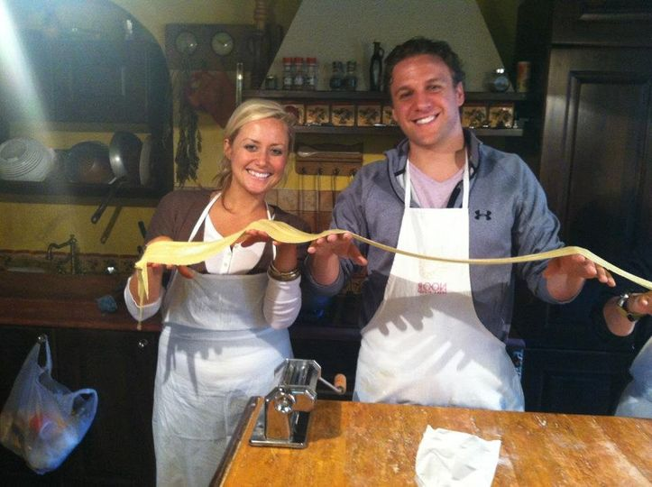 Sam and Ryan learning how to make pasta in Italy.