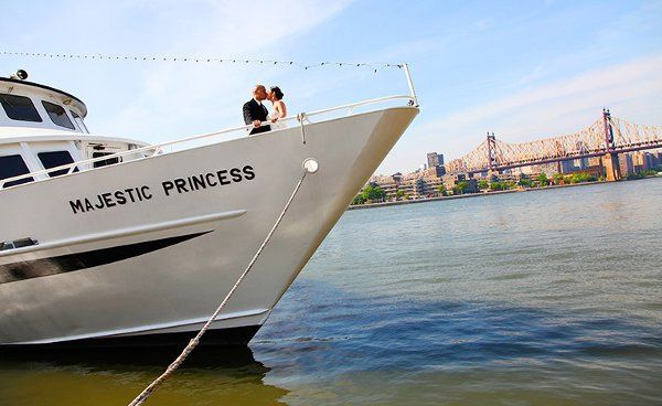 Boat Wedding, A couple on a boat overlooking New York. A view from Water's Edge, LIC