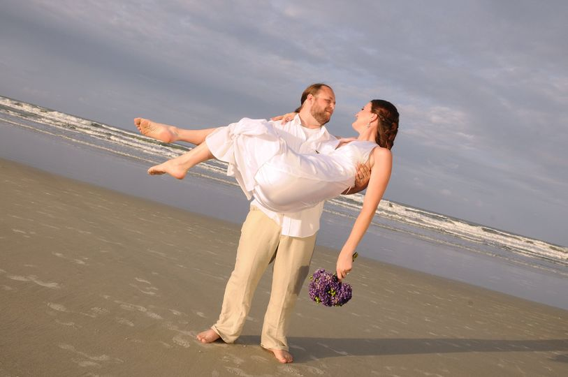 Groom lifting his bride