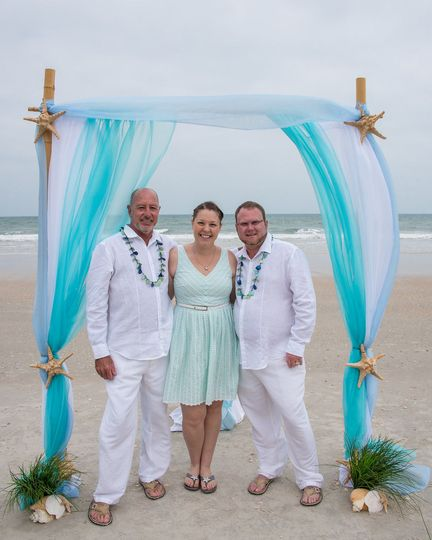 Officiant and the grooms