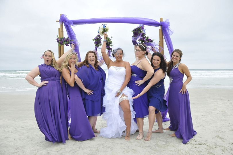 Bride and her bridesmaids in violet
