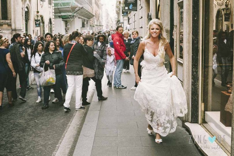 Bride going to the church through the ancient streets of Rome