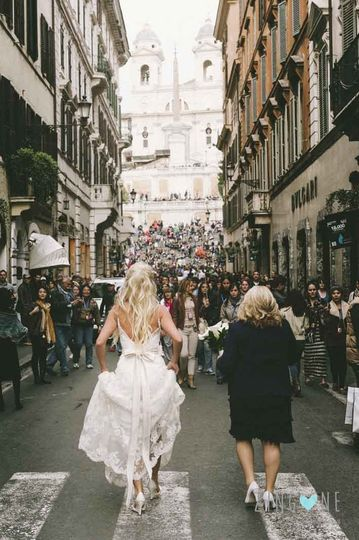 Bride and her mother going to the church through the ancient streets of Rome, near the Spanish...