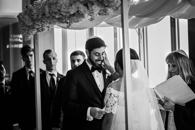 Bride wiping grooms tear