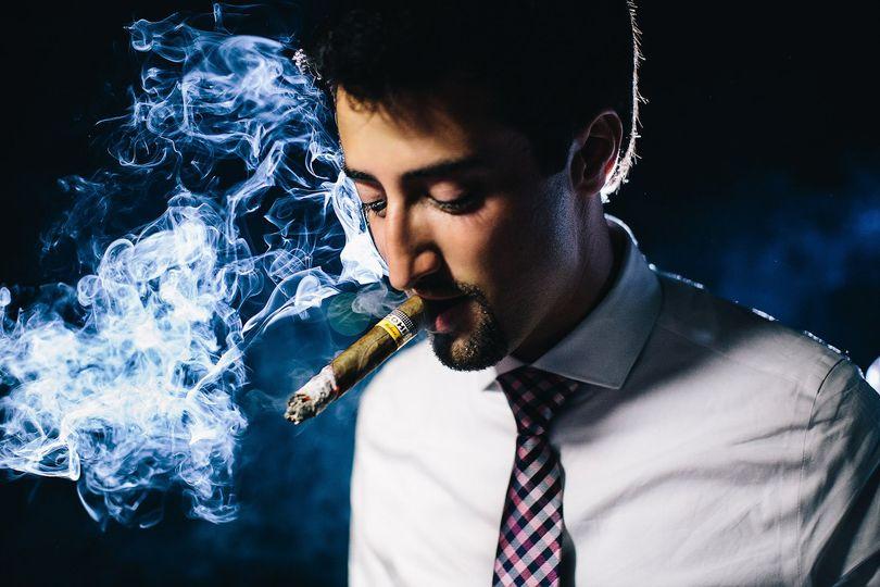 Grooms smoking cigar