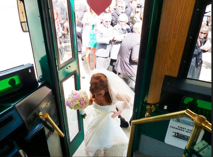 Bride getting on the trolley