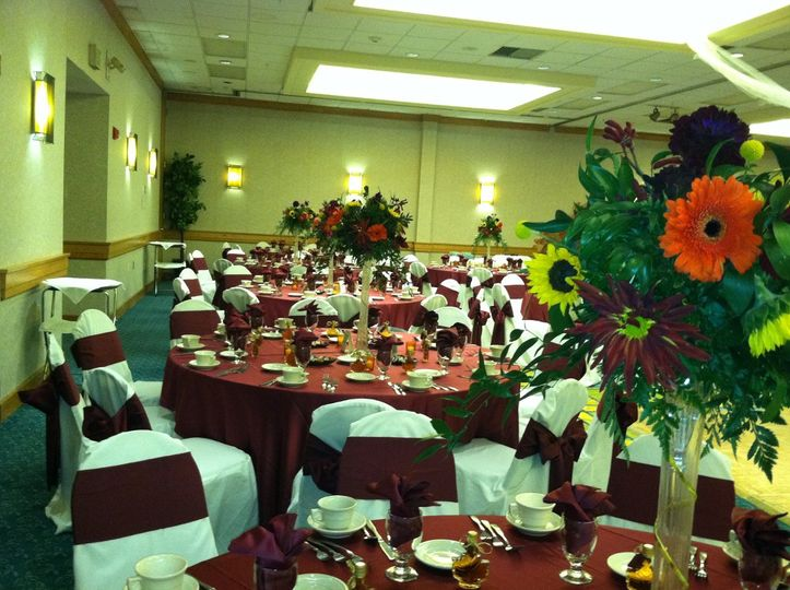 Reception tables and red decor