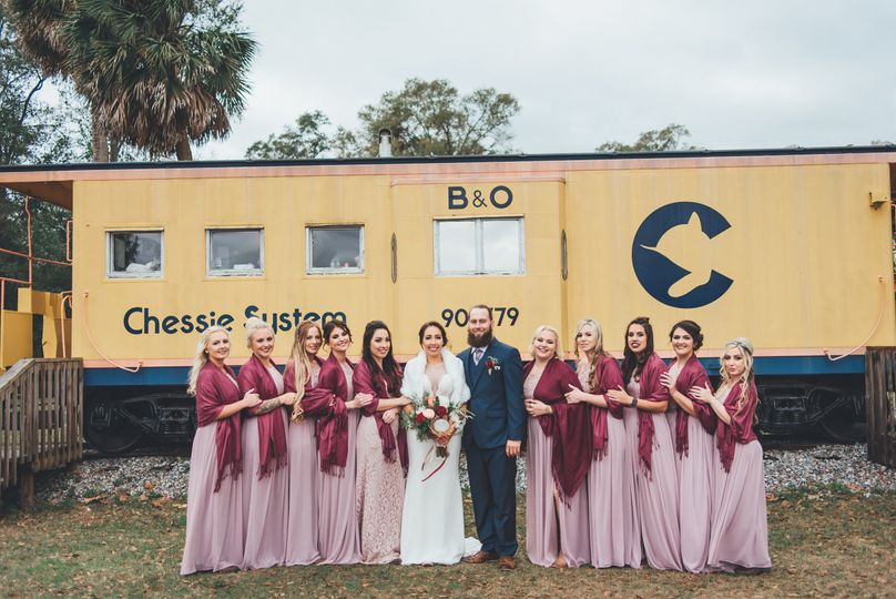 Wedding party picture in front of the Ms. Chessie caboose which was fully restored to beautiful...