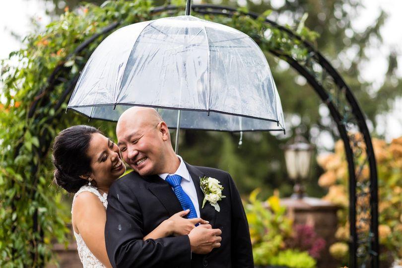 Smile couple in the rain