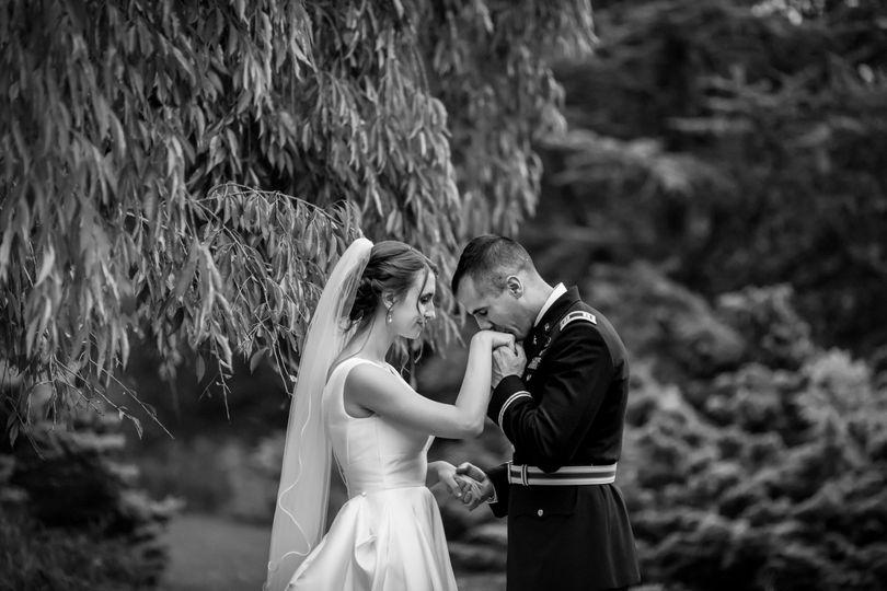 Military groom kisses bride