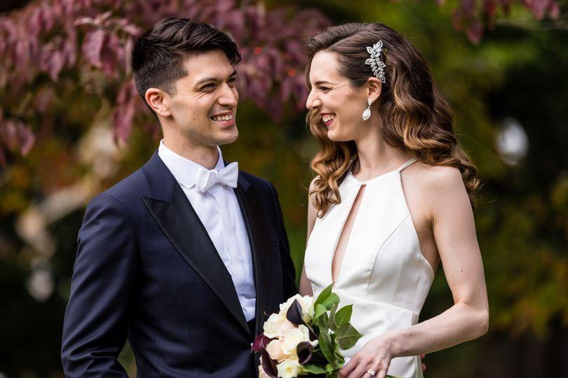 Laughing bride & groom