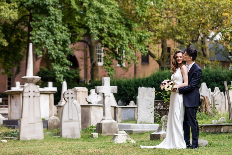 Bride & groom in graveyard
