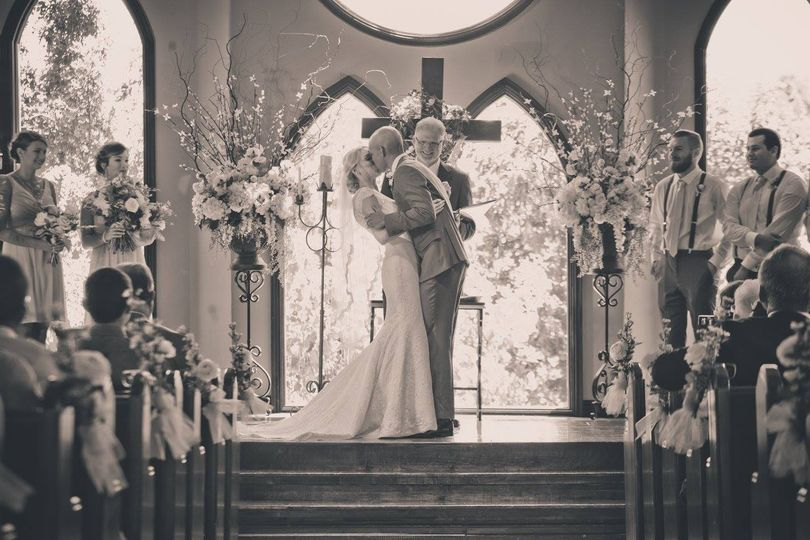newlyweds kiss at the altar