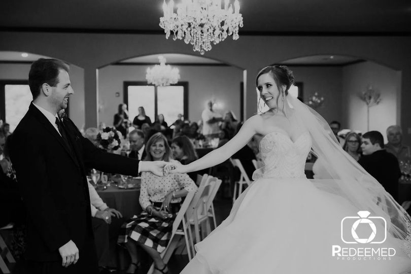 Newlyweds dance in black and white