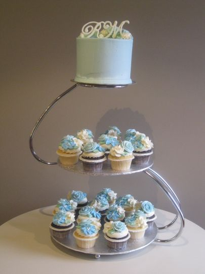 blue topper and flower cupcakes