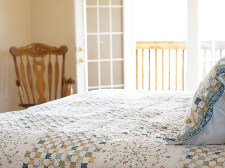 Tmx 1461294796002 Rugged Horizon Bedroom With Door Open Saint Ignatius, Montana wedding venue
